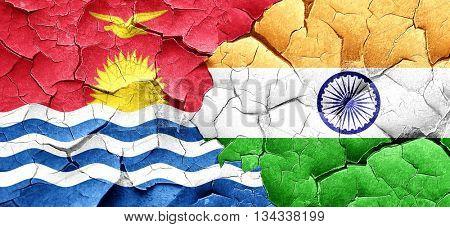 Kiribati flag with India flag on a grunge cracked wall