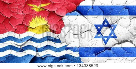 Kiribati flag with Israel flag on a grunge cracked wall
