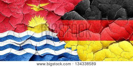Kiribati flag with Germany flag on a grunge cracked wall