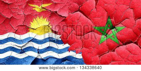 Kiribati flag with Morocco flag on a grunge cracked wall