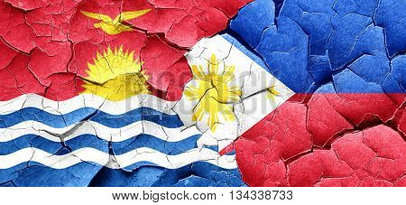 Kiribati flag with Philippines flag on a grunge cracked wall