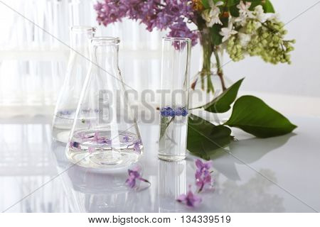 Flowers in test tubes on the table