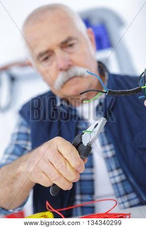 workman repairing an electrical cable