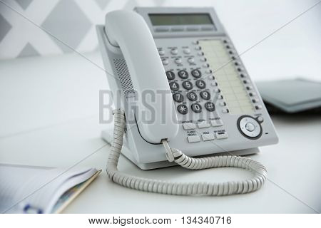 Office IP telephone on light background