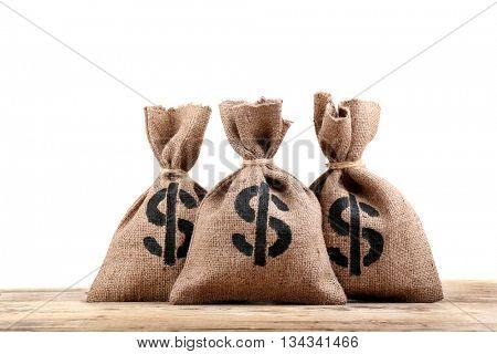 Sacks with money on white background
