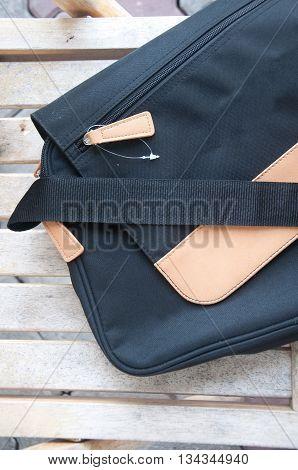 New messenger bag on wood table for man