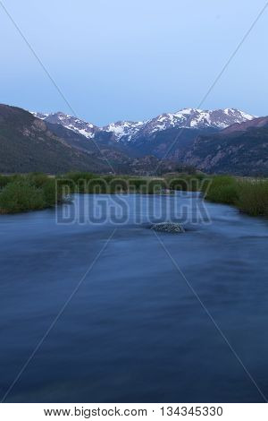 The Big Thompson River flows through Moraine Park in Rocky Mountain national Park before the sun rises on a summer day