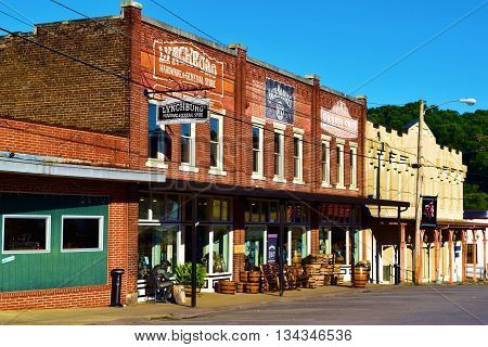 June 10, 2016 in Lynchburg, TN:  Historic brick buildings with retail stores and restaurants where tourists go shopping and dining surrounded by historic architecture taken in the rural town of Lynchburg, TN