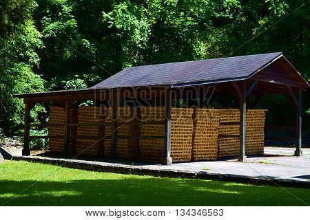 Outdoor shed which is used for the storage of wooden pallets