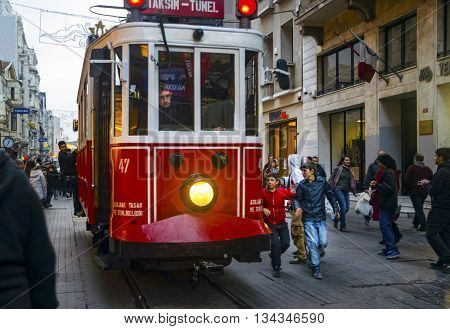 Istanbul Turkey - December 29 2013: Istiklal Street and Independence Avenue (Turkish: Independence Avenue) is visited by nearly 3 million people in a single day during the weekend in Istanbul Turkey it is one of the most famous streets. historic boutiques