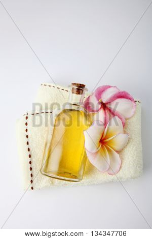 massage oil with frangipani and towel