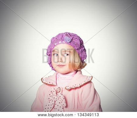 Little Girl In A Pink Coat And Beret On White Background.