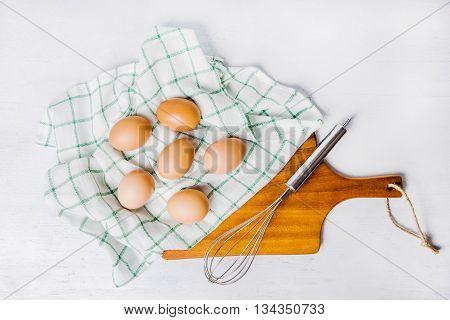 Raw Organic Brown Eggs Over Napkin