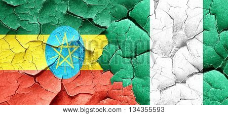 Ethiopia flag with Nigeria flag on a grunge cracked wall