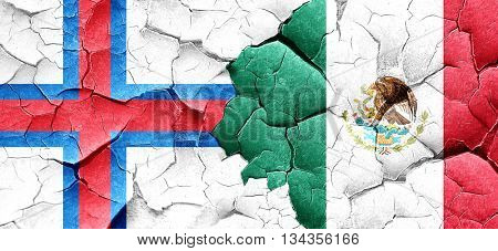 faroe islands flag with Mexico flag on a grunge cracked wall