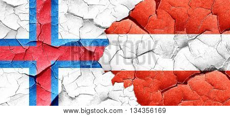 faroe islands flag with Austria flag on a grunge cracked wall