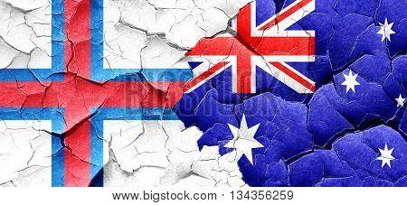 faroe islands flag with Australia flag on a grunge cracked wall