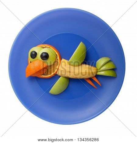 Funny crow made of banana on blue plate