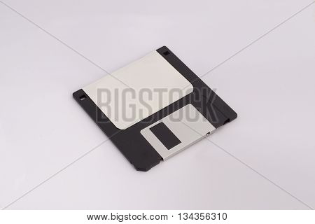 Floppy disk (black) with clear white label on white background.