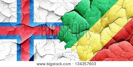 faroe islands flag with congo flag on a grunge cracked wall