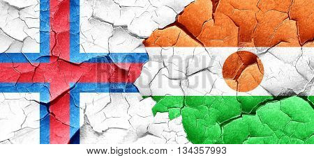 faroe islands flag with Niger flag on a grunge cracked wall