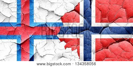 faroe islands flag with Norway flag on a grunge cracked wall