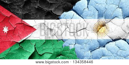 Jordan flag with Argentine flag on a grunge cracked wall