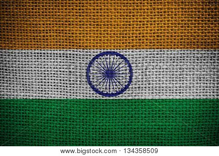 Texture of sackcloth with the image of the India flag