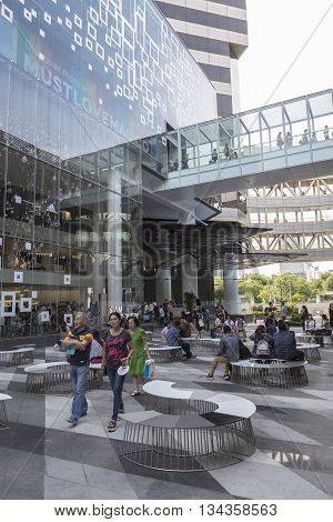 BANGKOK THAILAND - MAY 29 : unidentified tourist in activity space between Siam Center and Siam Discovery after renovate in siam square on may 29 2016 thailand. siam discovery and Siam Center is popular place in siam square