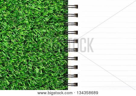 close up notebook on green grass background