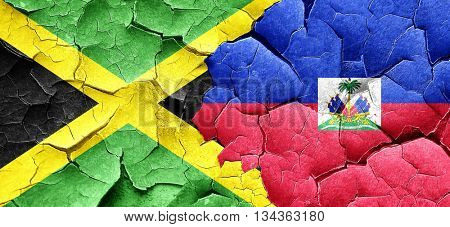 Jamaica flag with Haiti flag on a grunge cracked wall