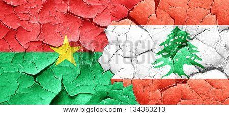 Burkina Faso flag with Lebanon flag on a grunge cracked wall
