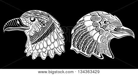 Hand Drawn heads of eagle. Doodle vector illustration isolated on black background. Sketch for tattoo or indian makhenda design. Can be used for postcard t-shirt bag or poster.