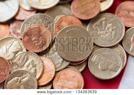 budget, finance, crisis and national currency concept - close up of american coins or money