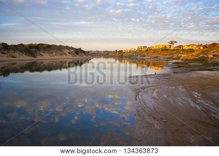 Overlooking the Onkaparinga River South Australia at sunset. Featuring the cloud formations reflected in the water.