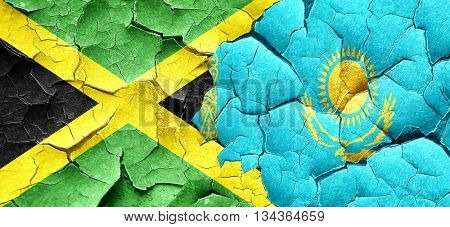 Jamaica flag with Kazakhstan flag on a grunge cracked wall
