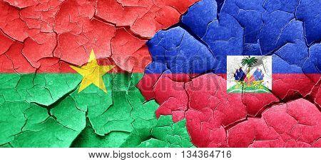 Burkina Faso flag with Haiti flag on a grunge cracked wall
