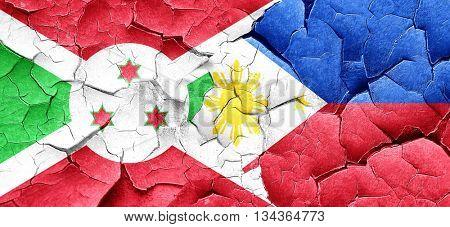 Burundi flag with Philippines flag on a grunge cracked wall