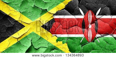 Jamaica flag with Kenya flag on a grunge cracked wall