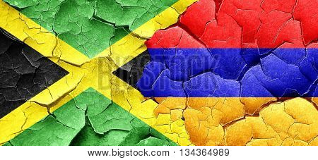 Jamaica flag with Armenia flag on a grunge cracked wall