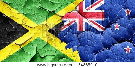 Jamaica flag with New Zealand flag on a grunge cracked wall