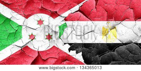 Burundi flag with egypt flag on a grunge cracked wall