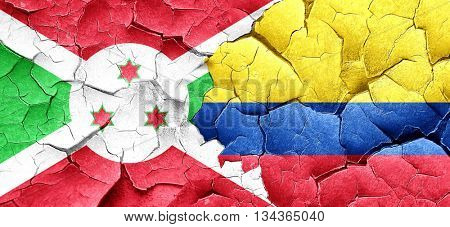 Burundi flag with Colombia flag on a grunge cracked wall