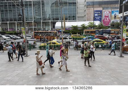 BANGKOK THAILAND - MAY 22 : tourist on pedestrian in Ratchaprasong area on may 22 2016 thailand. Ratchaprasong is one of is famous landmark of Bangkok