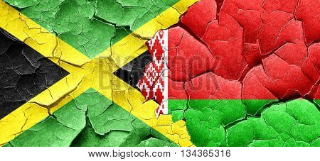 Jamaica flag with Belarus flag on a grunge cracked wall