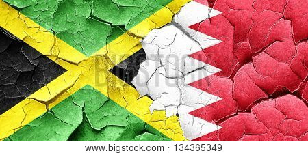 Jamaica flag with Bahrain flag on a grunge cracked wall