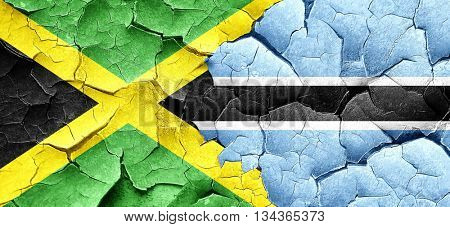 Jamaica flag with Botswana flag on a grunge cracked wall