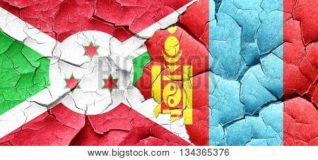 Burundi flag with Mongolia flag on a grunge cracked wall