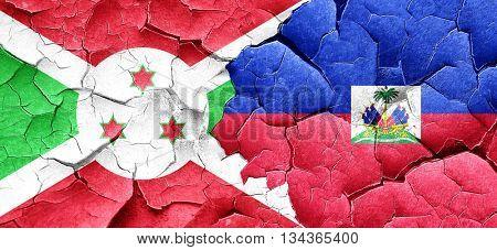 Burundi flag with Haiti flag on a grunge cracked wall