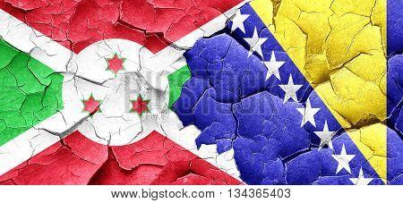 Burundi flag with Bosnia and Herzegovina flag on a grunge cracke